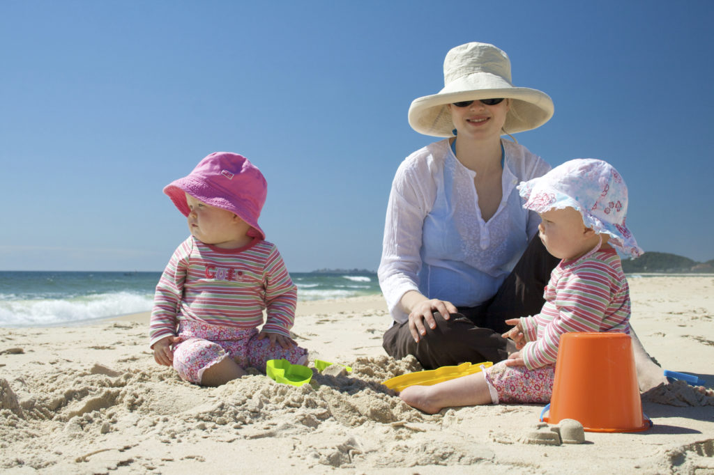 Woman with infants beach