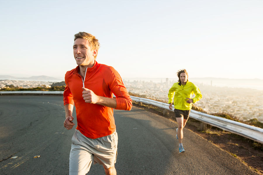 two young happy men running